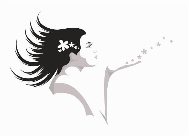 Girl blowing flowers away